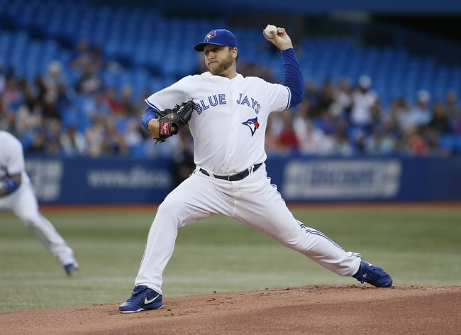 Aug 15, 2013; Toronto, Ontario, CAN; Toronto Blue Jays pitcher Mark Buehrle (56) throws against the Boston Red Sox at the Rogers Centre. Mandatory Credit: John E. Sokolowski-USA TODAY Sports