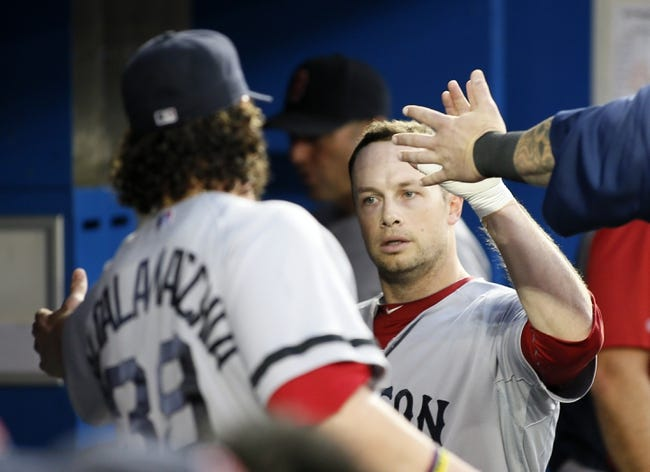 Aug 15, 2013; Toronto, Ontario, CAN; Boston Red Sox first baseman Daniel Nava (29) gets congratulated on scoring in the fourth inning against the Toronto Blue Jays at the Rogers Centre. Mandatory Credit: John E. Sokolowski-USA TODAY Sports