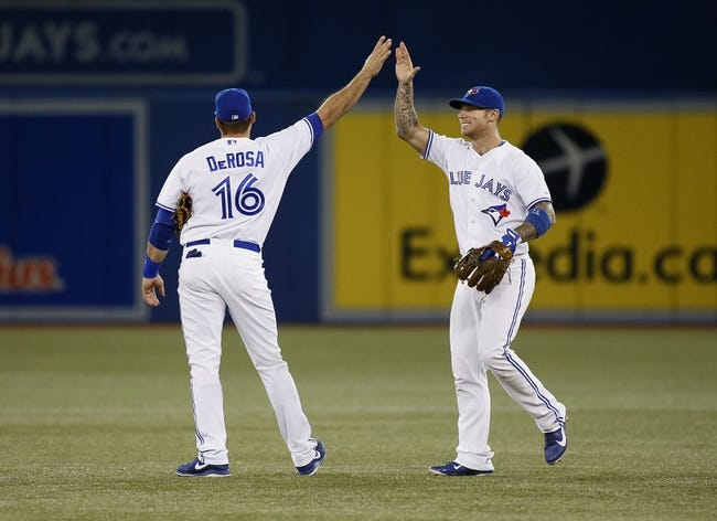 Aug 15, 2013; Toronto, Ontario, CAN; Toronto Blue Jays first baseman Mark DeRosa (16) and third baseman Brett Lawrie (13) celebrate a win over the Boston Red Sox at the Rogers Centre. Toronto defeated Boston 2-1. Mandatory Credit: John E. Sokolowski-USA TODAY Sports