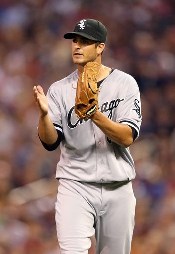 Aug 15, 2013; Minneapolis, MN, USA; Chicago White Sox starting pitcher Andre Rienzo (64) reacts after getting an out in the fourth inning against the Minnesota Twins at Target Field. Mandatory Credit: Jesse Johnson-USA TODAY Sports