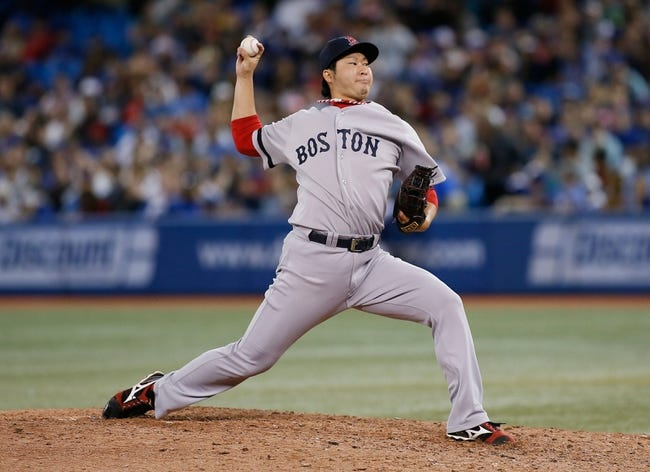 Aug 15, 2013; Toronto, Ontario, CAN; Boston Red Sox pitcher Junichi Tazawa (36) throws against the Toronto Blue Jays in the eighth inning at the Rogers Centre. Toronto defeated Boston 2-1. Mandatory Credit: John E. Sokolowski-USA TODAY Sports