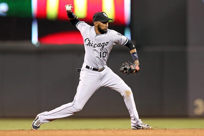 Aug 15, 2013; Minneapolis, MN, USA; Chicago White Sox shortstop Alexei Ramirez (10) throws the ball to first base in the sixth inning against the Minnesota Twins at Target Field. Mandatory Credit: Jesse Johnson-USA TODAY Sports