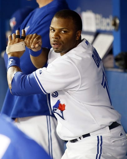 Aug 15, 2013; Toronto, Ontario, CAN; Toronto Blue Jays centre fielder Rajai Davis (11) practices his swing in the dugout against the Boston Red Sox at the Rogers Centre. Toronto defeated Boston 2-1. Mandatory Credit: John E. Sokolowski-USA TODAY Sports