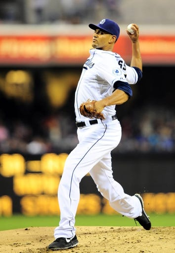 Aug 15, 2013; San Diego, CA, USA; San Diego Padres starting pitcher Tyson Ross (38) throws during the third inning against the New York Mets at Petco Park. Mandatory Credit: Christopher Hanewinckel-USA TODAY Sports