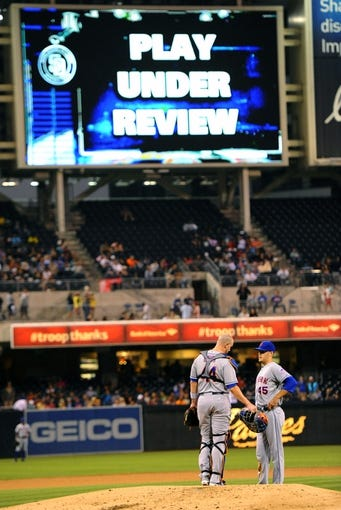 Aug 15, 2013; San Diego, CA, USA; New York Mets starting pitcher Zack Wheeler (45) talks with catcher John Buck (44) as umpires review a play during the third inning against the San Diego Padres at Petco Park. Mandatory Credit: Christopher Hanewinckel-USA TODAY Sports