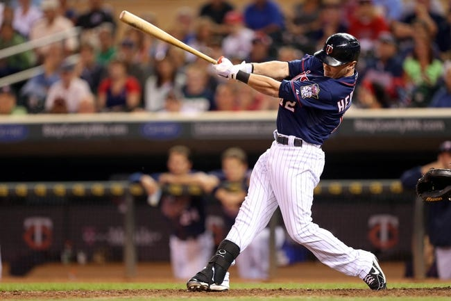 Aug 15, 2013; Minneapolis, MN, USA; Minnesota Twins pinch hitter Chris Herrmann (12) hits a game winning RBI single in the ninth inning against the Chicago White Sox at Target Field. The Twins won 4-3. Mandatory Credit: Jesse Johnson-USA TODAY Sports