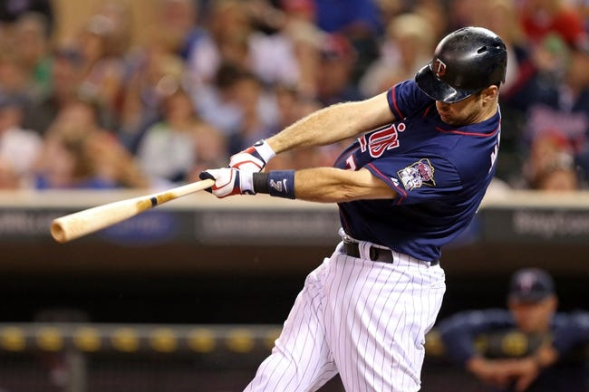 Aug 15, 2013; Minneapolis, MN, USA; Minnesota Twins catcher Joe Mauer (7) hits a double in the eighth inning against the Chicago White Sox at Target Field. The Twins won 4-3. Mandatory Credit: Jesse Johnson-USA TODAY Sports