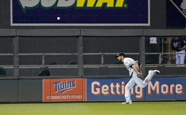 Aug 15, 2013; Minneapolis, MN, USA; Chicago White Sox center fielder Jordan Danks (20) chases after a fly ball in the eighth inning against the Minnesota Twins at Target Field. The Twins won 4-3. Mandatory Credit: Jesse Johnson-USA TODAY Sports
