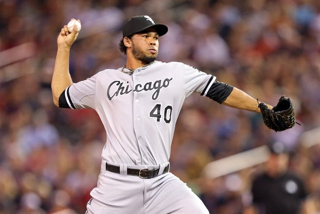 Aug 15, 2013; Minneapolis, MN, USA; Chicago White Sox relief pitcher Ramon Troncoso (40) delivers a pitch in the ninth inning against the Minnesota Twins at Target Field. The Twins won 4-3. Mandatory Credit: Jesse Johnson-USA TODAY Sports