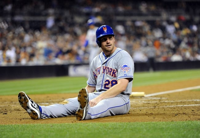 Aug 15, 2013; San Diego, CA, USA; New York Mets second baseman Daniel Murphy (28) after scoring during the fourth inning against the San Diego Padres at Petco Park. Mandatory Credit: Christopher Hanewinckel-USA TODAY Sports