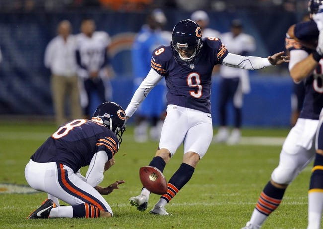 Aug 15, 2013; Chicago, IL, USA; Chicago Bears kicker Robbie Gould (9) kicks a 48 yard field goal with punter Adam Podlesh (8) holding during the second half against the San Diego Chargers at Soldier Field. Chicago won 33-28. Mandatory Credit: Dennis Wierzbicki-USA TODAY Sports