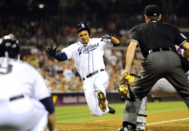 Aug 15, 2013; San Diego, CA, USA; San Diego Padres starting pitcher Tyson Ross (38) before being tagged out at the plate by New York Mets catcher John Buck (44) during the fifth inning at Petco Park. Mandatory Credit: Christopher Hanewinckel-USA TODAY Sports