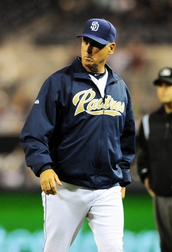 Aug 15, 2013; San Diego, CA, USA; San Diego Padres manager Bud Black (20) walks back to the dugout after questioning a call during the third inning against the New York Mets at Petco Park. Mandatory Credit: Christopher Hanewinckel-USA TODAY Sports