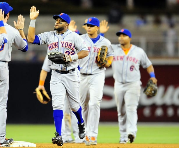 Aug 15, 2013; San Diego, CA, USA; New York Mets left fielder Eric Young Jr. (22) celebrates with teammates after a 4-1 win against the San Diego Padres at Petco Park. Mandatory Credit: Christopher Hanewinckel-USA TODAY Sports