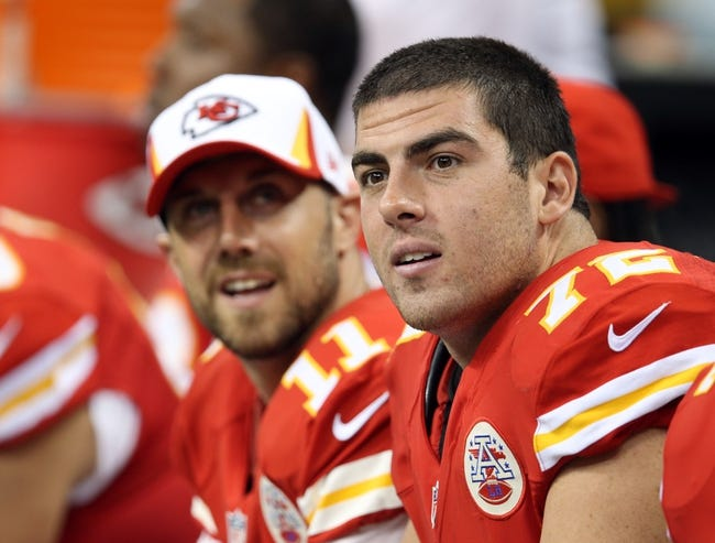 Aug 9, 2013; New Orleans, LA, USA; Kansas City Chiefs offensive tackle Eric Fisher (72) on the bench with quarterback Alex Smith during the fourth quarter of their game against the New Orleans Saints at the Mercedes-Benz Superdome. Mandatory Credit: Chuck Cook-USA TODAY Sports