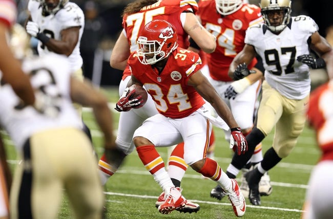 Aug 9, 2013; New Orleans, LA, USA; Kansas City Chiefs running back Knile Davis (34) during the first quarter of their game against the New Orleans Saints at the Mercedes-Benz Superdome. Mandatory Credit: Chuck Cook-USA TODAY Sports