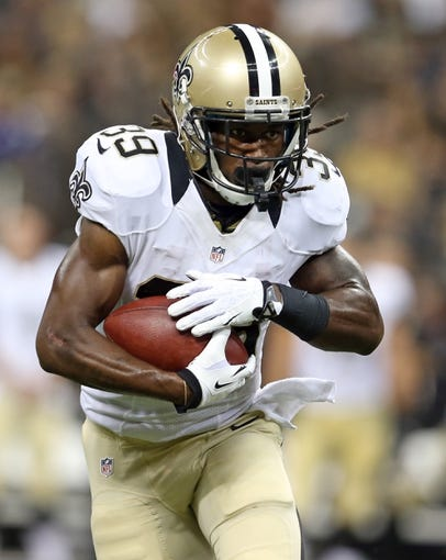 Aug 9, 2013; New Orleans, LA, USA; New Orleans Saints running back Travaris Cadet (39) runs with the football during the second quarter of their game against the Kansas City Cheifs at the Mercedes-Benz Superdome. Mandatory Credit: Chuck Cook-USA TODAY Sports