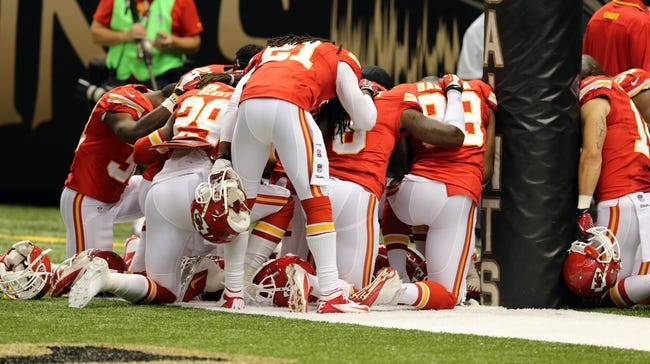 Aug 9, 2013; New Orleans, LA, USA; Kansas City Chiefs players gather around the goal post to pray before their game against the New Orleans Saints at the Mercedes-Benz Superdome. Mandatory Credit: Chuck Cook-USA TODAY Sports