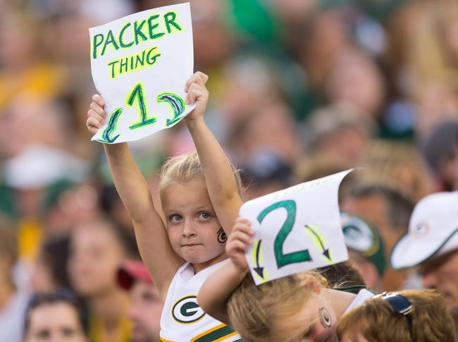 Aug 9, 2013; Green Bay, WI, USA; A young Green Bay Packers fan during the game against the Arizona Cardinals at Lambeau Field.  The Cardinals won 17-0.  Mandatory Credit: Jeff Hanisch-USA TODAY Sports