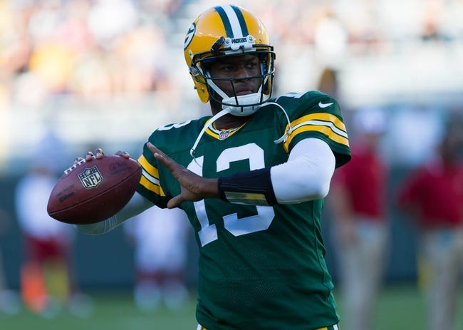 Aug 9, 2013; Green Bay, WI, USA; Green Bay Packers quarterback Vince Young (13) during warmups prior to the game against the Arizona Cardinals at Lambeau Field.  The Cardinals won 17-0.  Mandatory Credit: Jeff Hanisch-USA TODAY Sports