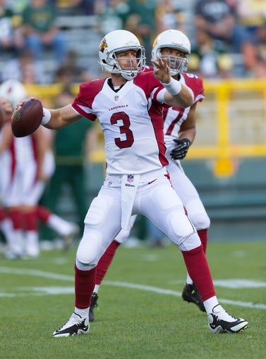 Aug 9, 2013; Green Bay, WI, USA; Arizona Cardinals quarterback Carson Palmer (3) during warmups prior to the game against the Green Bay Packers at Lambeau Field.  The Cardinals won 17-0.  Mandatory Credit: Jeff Hanisch-USA TODAY Sports