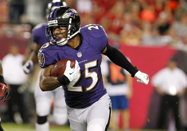 Aug 8, 2013; Tampa, FL, USA; Baltimore Ravens cornerback Asa Jackson (25) runs with the ball after he intercepted the ball against the Tampa Bay Buccaneers during the second half at Raymond James Stadium. Mandatory Credit: Kim Klement-USA TODAY Sports