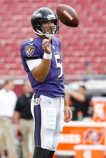 Aug 8, 2013; Tampa, FL, USA; Baltimore Ravens quarterback Joe Flacco (5) prior to the game against the Tampa Bay Buccaneers at Raymond James Stadium. Mandatory Credit: Kim Klement-USA TODAY Sports