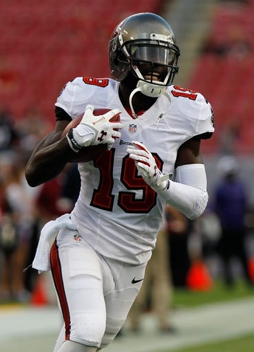 Aug 8, 2013; Tampa, FL, USA;Tampa Bay Buccaneers wide receiver Mike Williams (19) prior to the game against the Baltimore Ravens at Raymond James Stadium. Mandatory Credit: Kim Klement-USA TODAY Sports