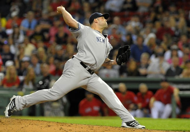 Aug 16, 2013; Boston, MA, USA; New York Yankees relief pitcher Joba Chamberlain (62) pitches during the ninth inning against the Boston Red Sox at Fenway Park. Mandatory Credit: Bob DeChiara-USA TODAY Sports