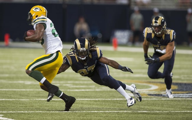 Aug 17, 2013; St. Louis, MO, USA; St. Louis Rams safety Matt Daniels (37) misses a tackle on Green Bay Packers running back Johnathan Franklin (23) during the first half at the Edward Jones Dome. Mandatory Credit: Jeff Curry-USA TODAY Sports