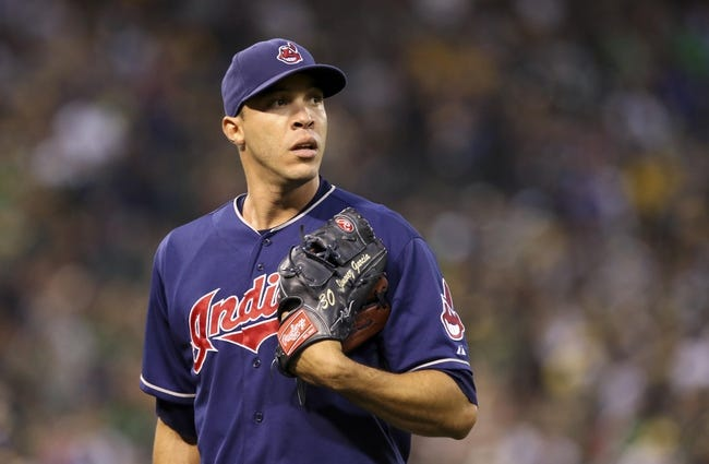 Aug 17, 2013; Oakland, CA, USA; Cleveland Indians starting pitcher Ubaldo Jimenez (30) leaves the field after being replaced after allowing the first hit by the Oakland Athletics during the sixth inning at O.co Coliseum. Mandatory Credit: Kelley L Cox-USA TODAY Sports