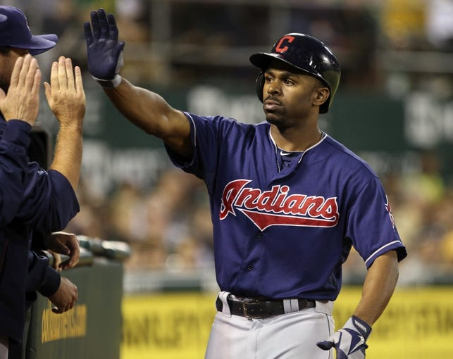 Aug 17, 2013; Oakland, CA, USA; Cleveland Indians center fielder Michael Bourn (24) celebrates with teammates after hitting a solo home run against the Oakland Athletics during the seventh inning at O.co Coliseum. Mandatory Credit: Kelley L Cox-USA TODAY Sports