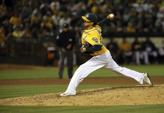 Aug 17, 2013; Oakland, CA, USA; Oakland Athletics relief pitcher Jesse Chavez (60) pitches the ball against the Cleveland Indians during the eighth inning at O.co Coliseum. Mandatory Credit: Kelley L Cox-USA TODAY Sports
