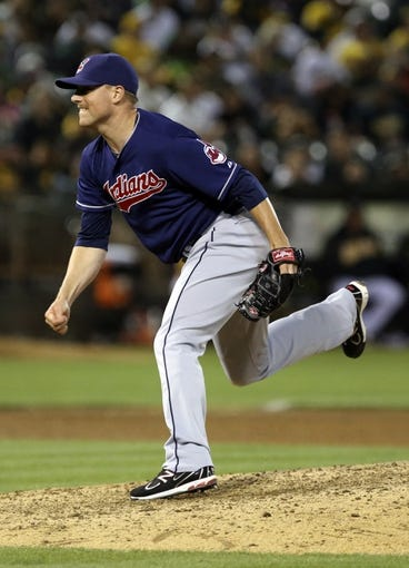 Aug 17, 2013; Oakland, CA, USA; Cleveland Indians relief pitcher Joe Smith (38) pitches the ball against the Oakland Athletics during the eighth inning at O.co Coliseum. Mandatory Credit: Kelley L Cox-USA TODAY Sports