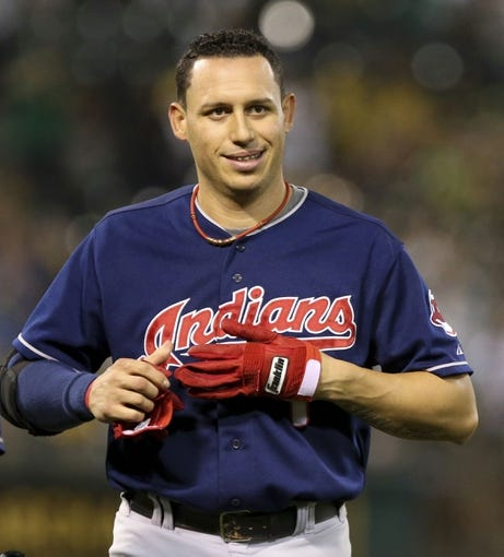 Aug 17, 2013; Oakland, CA, USA; Cleveland Indians shortstop Asdrubal Cabrera (13) removes his batting glove after an out against the Oakland Athletics during the eighth inning at O.co Coliseum. Mandatory Credit: Kelley L Cox-USA TODAY Sports
