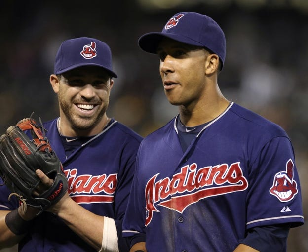Aug 17, 2013; Oakland, CA, USA; Cleveland Indians second baseman Jason Kipnis (22) smiles with left fielder Michael Brantley (23) at the end of the eighth inning against the Oakland Athletics at O.co Coliseum. Mandatory Credit: Kelley L Cox-USA TODAY Sports