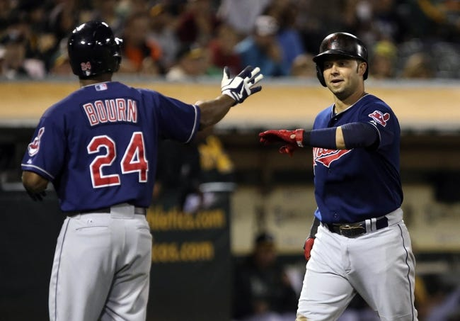 Aug 17, 2013; Oakland, CA, USA; Cleveland Indians first baseman Nick Swisher (33) celebrates with center fielder Michael Bourn (24) after both scoring against the Oakland Athletics during the ninth inning at O.co Coliseum. The Cleveland Indians defeated the Oakland Athletics 7-1. Mandatory Credit: Kelley L Cox-USA TODAY Sports