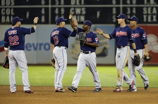 Aug 17, 2013; Oakland, CA, USA; Cleveland Indians center fielder Michael Bourn (24), left fielder Michael Brantley (23) and right fielder Drew Stubbs (11) high five second baseman Jason Kipnis (22) and shortstop Asdrubal Cabrera (13) after the win against the Oakland Athletics at O.co Coliseum. The Cleveland Indians defeated the Oakland Athletics 7-1. Mandatory Credit: Kelley L Cox-USA TODAY Sports