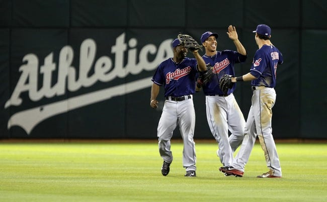 Aug 17, 2013; Oakland, CA, USA; Cleveland Indians center fielder Michael Bourn (24), left fielder Michael Brantley (23) and right fielder Drew Stubbs (11) celebrate after the win against the Oakland Athletics at O.co Coliseum. The Cleveland Indians defeated the Oakland Athletics 7-1. Mandatory Credit: Kelley L Cox-USA TODAY Sports