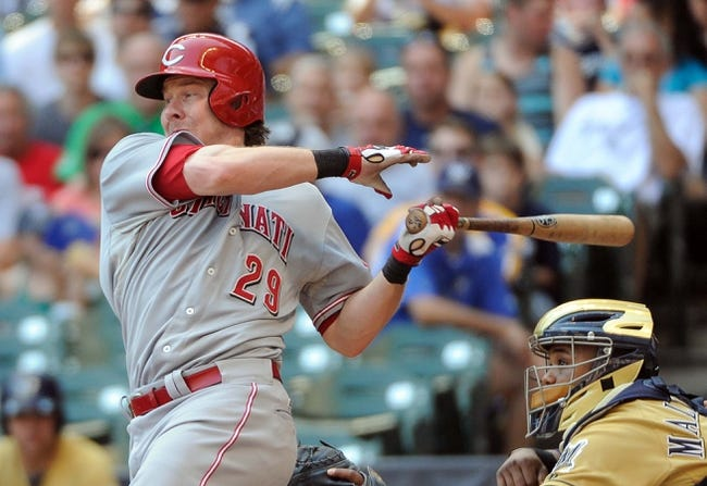 Aug 18, 2013; Milwaukee, WI, USA;  Cincinnati Reds catcher Ryan Hanigan hits a single to drive in a run in the fifth inning against the Milwaukee Brewers at Miller Park. Mandatory Credit: Benny Sieu-USA TODAY Sports