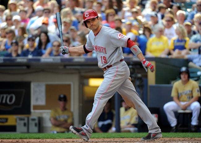 Aug 18, 2013; Milwaukee, WI, USA;  Cincinnati Reds first baseman Joey Votto tosses his bat away after getting a walk to force in a run during the game against the Milwaukee Brewers in the fifth inning at Miller Park. Mandatory Credit: Benny Sieu-USA TODAY Sports