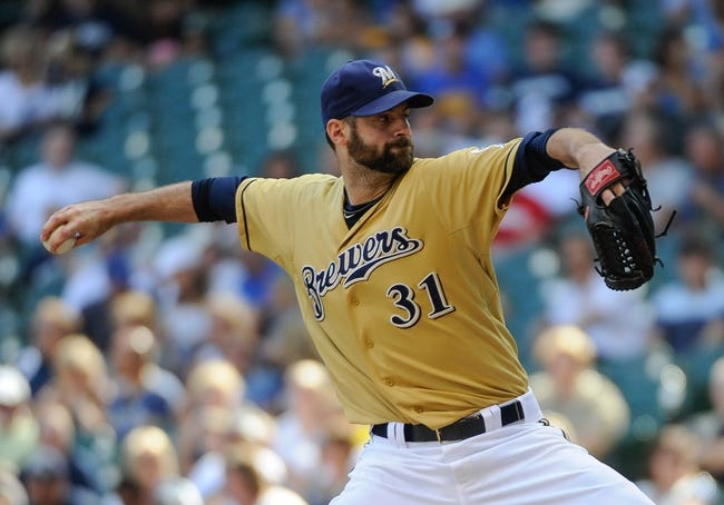 Aug 18, 2013; Milwaukee, WI, USA;  Milwaukee Brewers pitcher Burke Badenhop pitches in the eighth inning against the Cincinnati Reds at Miller Park. Mandatory Credit: Benny Sieu-USA TODAY Sports