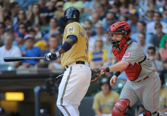 Aug 18, 2013; Milwaukee, WI, USA;  Cincinnati Reds catcher Ryan Hanigan (right) tags out Milwaukee Brewers first baseman Yuniesky Betancourt (left)after a striking out on a pitch in the dirt in the second inning at Miller Park. Mandatory Credit: Benny Sieu-USA TODAY Sports