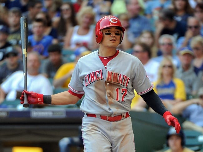 Aug 18, 2013; Milwaukee, WI, USA;  Cincinnati Reds center fielder Shin-Soo Choo tosses away his bat after drawing a walk in the forth inning during the game against the Milwaukee Brewers at Miller Park.  Choo reached base five times with three walks and two base hits to help the Reds beat the Brewers 9-1.   Mandatory Credit: Benny Sieu-USA TODAY Sports