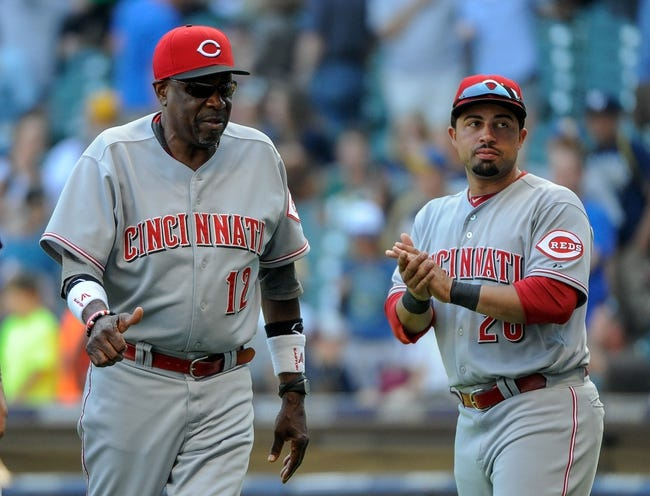 Aug 18, 2013; Milwaukee, WI, USA;  Cincinnati Reds manager Dusty Baker celebrates with left fielder Xavier Paul after the Reds beat the Milwaukee Brewers 9-1 at Miller Park. Mandatory Credit: Benny Sieu-USA TODAY Sports