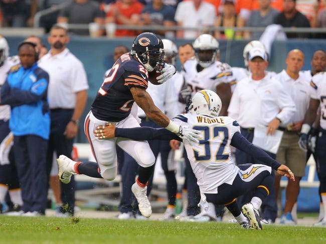Aug 15, 2013; Chicago, IL, USA; Chicago Bears running back Matt Forte (22) evades San Diego Chargers free safety Eric Weddle (32) during a 58 yard run in the first half at Soldier Field. Chicago won 33-28. Mandatory Credit: Dennis Wierzbicki-USA TODAY Sports
