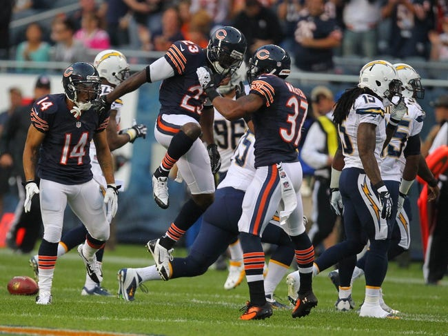 Aug 15, 2013; Chicago, IL, USA; Chicago Bears wide receiver Devin Hester (23) celebrates his kick return with free safety Anthony Walters (37) during the first half against the San Diego Chargers at Soldier Field. Chicago won 33-28. Mandatory Credit: Dennis Wierzbicki-USA TODAY Sports