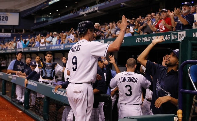Aug 15, 2013; St. Petersburg, FL, USA; Tampa Bay Rays right fielder Wil Myers (9) and third baseman Evan Longoria (3) are congratulated by teammates after they scored during the fifth inning against the Seattle Mariners at Tropicana Field. Mandatory Credit: Kim Klement-USA TODAY Sports