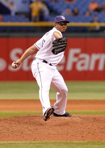 Aug 15, 2013; St. Petersburg, FL, USA; Tampa Bay Rays relief pitcher Wesley Wright (49) throws a pitch against the Seattle Mariners at Tropicana Field. Tampa Bay Rays defeated the Seattle Mariners 7-1. Mandatory Credit: Kim Klement-USA TODAY Sports