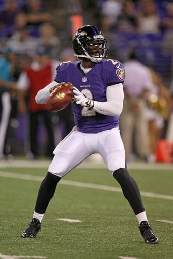 Aug 15, 2013; Baltimore, MD, USA; Baltimore Ravens quarterback Tyrod Taylor (2) during the game against the Atlanta Falcons at M&T Bank Stadium. Mandatory Credit: Mitch Stringer-USA TODAY Sports